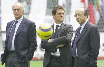 Juventus officials Antonio Giraudo (left) and Luciano Moggi (right) with team coach Fabio Capello.