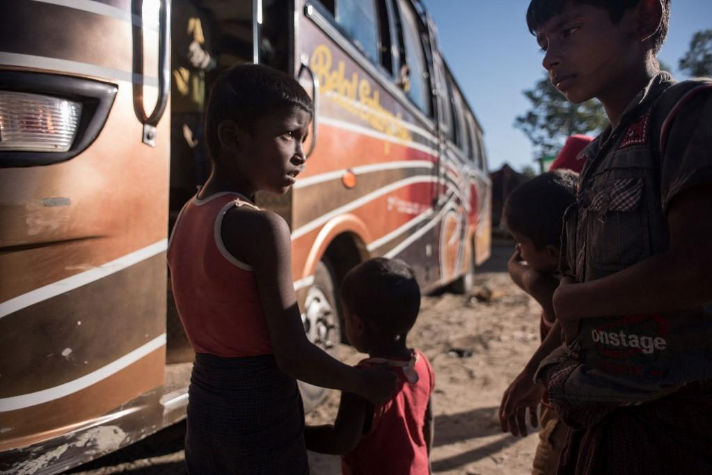 Rohingya children board a bus before departing to a refugee camp in Bangladesh after arriving from Myanmar in 2017. Photo: AFP