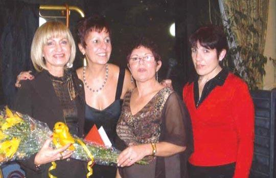 Valerie Portelli Hunt, Slimming UK consultant, receiving flowers from members of the club.