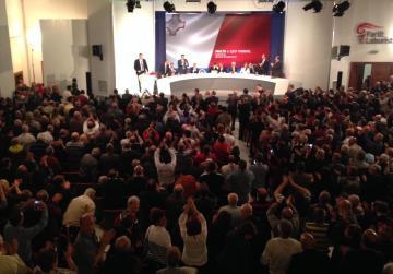 Delegates applaud as Konrad Mizzi starts his address