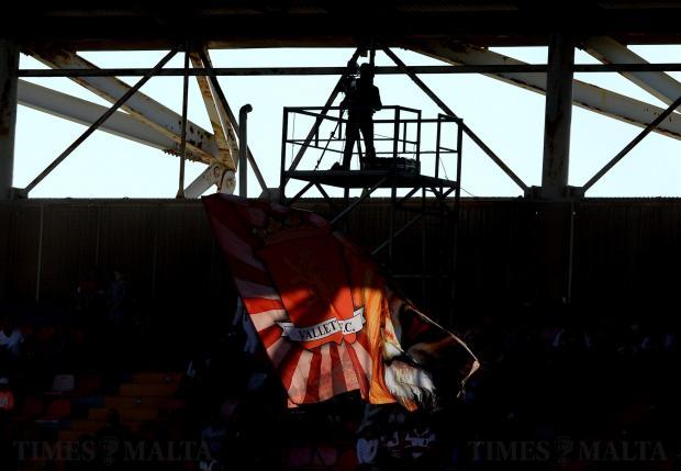 A Valletta football club flag catches the light as Valletta prepare to take on Birkirkara at the National Stadium in Ta'Qali on April 15. Photo: Matthew Mirabelli