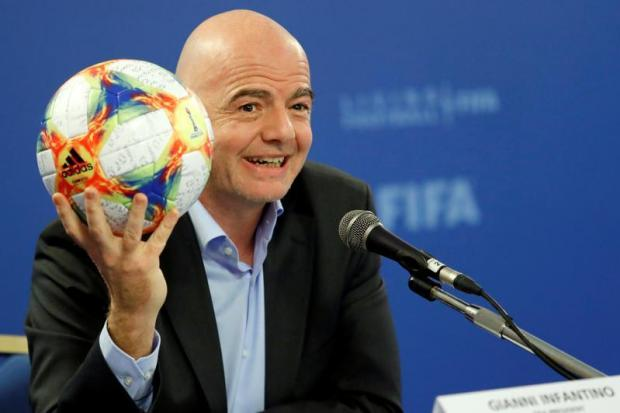 FIFA President Gianni Infantino shows an official ball of the 2019 FIFA Women's World Cup.