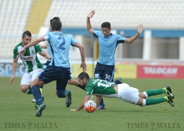 Floriana's Jurgen Pisani (right) is brought down during their Premier League match against Sliema Wanderers at the National Stadium in Ta' Qali on October 1. Photo: Matthew Mirabelli