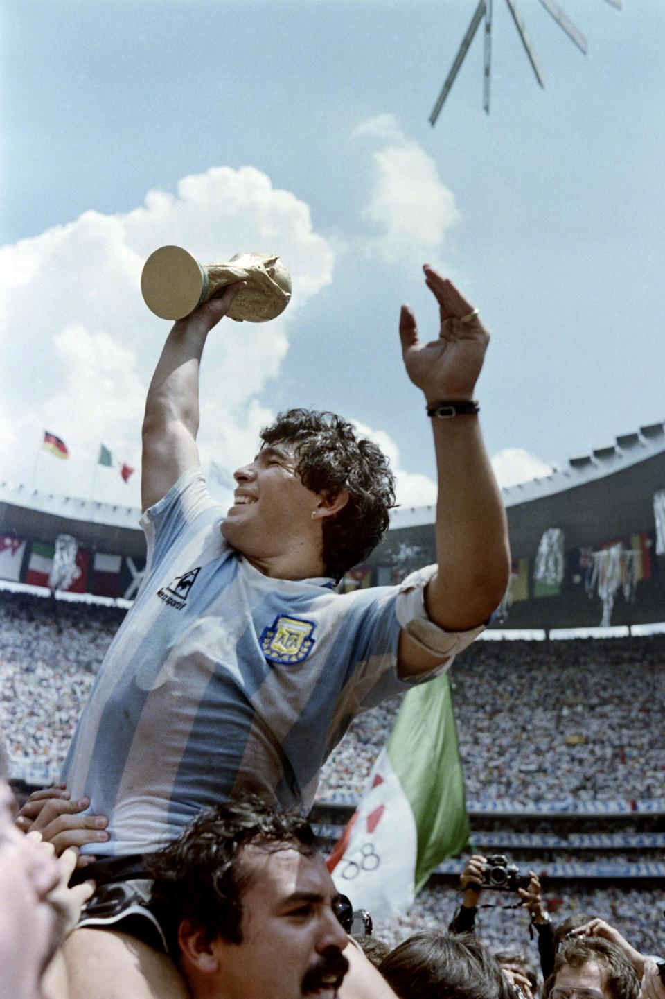 Maradona is held up high as he lifts the 1986 World Cup. Photo: AFP