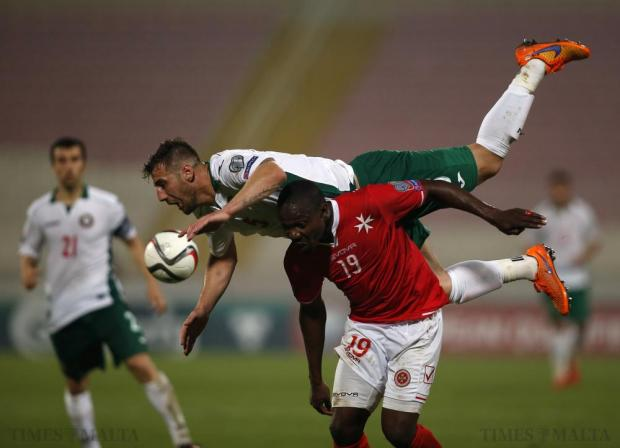 Bulgaria's Nikolay Bodurov (top) challenges Malta's Alfred Effiong for a high ball during their Euro 2016 Group H qualification soccer match at the National Stadium in Ta' Qali on June 12. Photo: Darrin Zammit Lupi