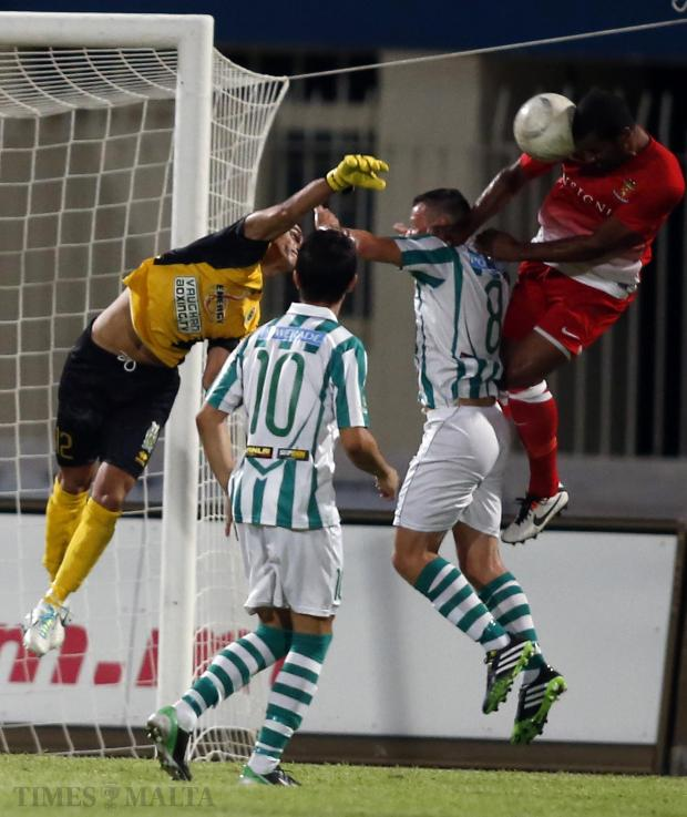 Valletta's Jason Vandelannoite (R) tries to head the ball past Floriana goalkeeper Sean Mintoff during their Premier League match at the National Stadium on August 31. Photo: Darrin Zammit Lupi
