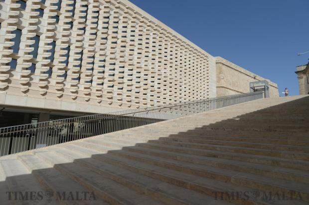 A lady prepares to walk down the stairs adjacent to the Parliament building in Valletta on July 2. Photo: Matthew Mirabelli