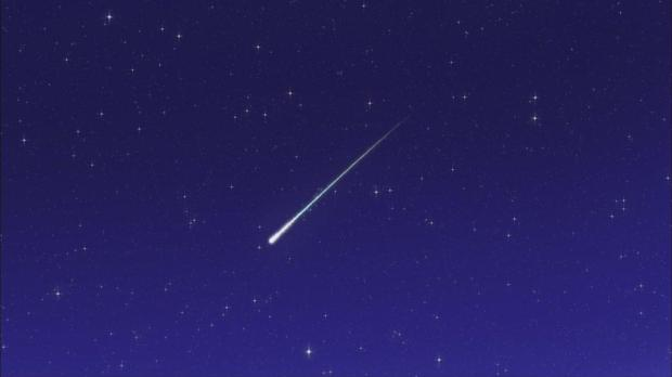 A meteor streaking across the sky.