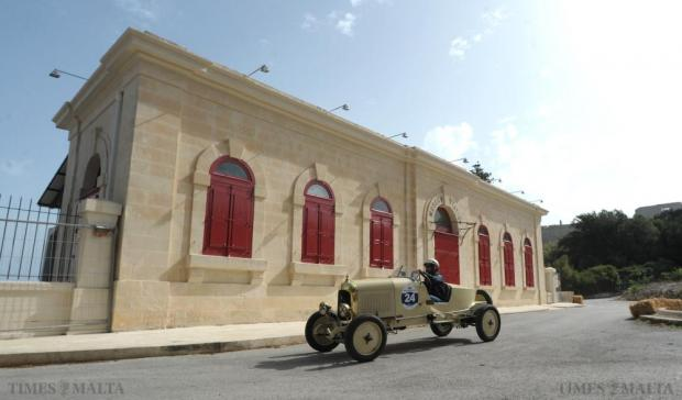 A car participating in the Mdina Grand Prix Classic Car event passes by the old Railway Station beneath Mdina which formed part of the challenging circuit outside Mdina's fortified walls on October 10. Photo: Matthew Mirabelli