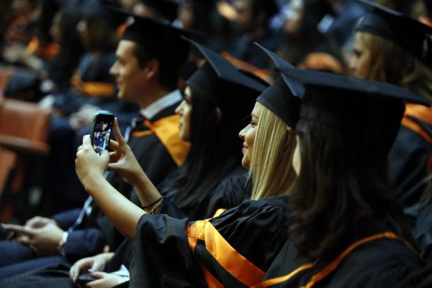 A University of Malta student takes a selfie on her phone during a graduation ceremony at the university in Tal-Qroqq on November 18. Photo: Darrin Zammit Lupi
