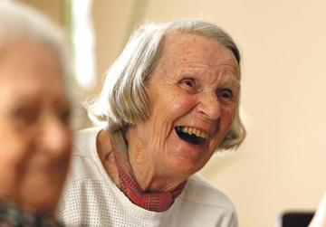 A resident laughs during an activity session.