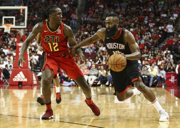 Houston Rockets guard James Harden (13) dribbles the ball as Atlanta Hawks forward Taurean Prince (12) defends during the third quarter at Toyota Center. Photo Credit: Troy Taormina-USA TODAY Sports