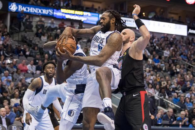 Dallas Mavericks center DeAndre Jordan (6) grabs a rebound in front of LA Clippers center Marcin Gortat (13) during the second half at the American Airlines Center. Mandatory Credit: Jerome Miron-USA TODAY Sports