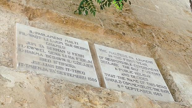 "Two small plaques in Maltese and English on Great Siege Road, in Floriana stating: ""The Maltese Parliament, in the first year of responsible government, declared the day of Victory a public holiday and decided that the name of this road should commemorate the date of 8th September 1565."""