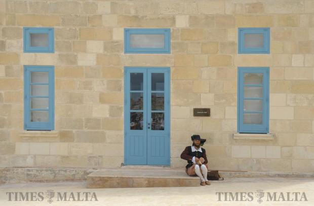 A re-enactor pauses for a break during an open day at Fort St Angelo in Vittoriosa on September 8, after the fort underwent extensive restoration works. Photo: Matthew Mirabelli