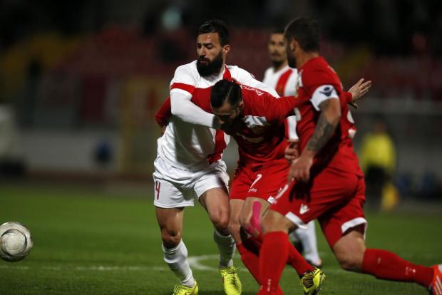 Valletta's Steve Borg (left) and Naxxar Lions' Terence Vella fight for the ball during their Premier League football match at the National Stadium in Ta' Qali on April 6. Photo: Darrin Zammit Lupi