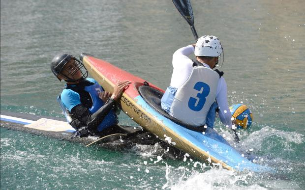 Two canoes collide during a canoe polo match at Dock 1 in Cospicua on October 22. Photo: Matthew Mirabelli
