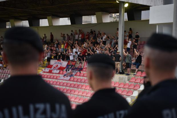 A member from the Malta Police force rapid intervention unit keeps a close watch on some Red Star Belgrade supporters during an Europa League qualifying game against Floriana FC at Hibernians Stadium on July 6. Photo: Mark Zammit Cordina