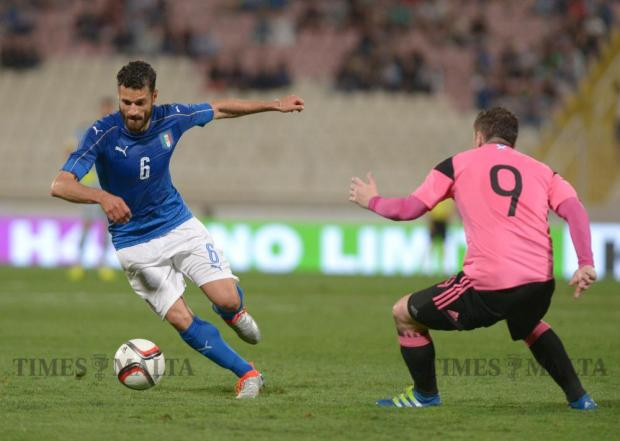 Italy's Antonio Candreva (left) vies with Scotland's Ross McCormack during their friendly football match at the National Stadium in Ta' Qali on May 29. Photo: Matthew Mirabelli