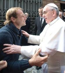 Pope Francis speaks with a priest friend who surprised him by travelling from Latin America to attend his Mass at Santa Anna church inside the Vatican yesterday. The Pope recognised the priest in the crowd when he went outside to greet the people and invited him to participate in the Mass. Photo: Reuters/Osservatore Romano