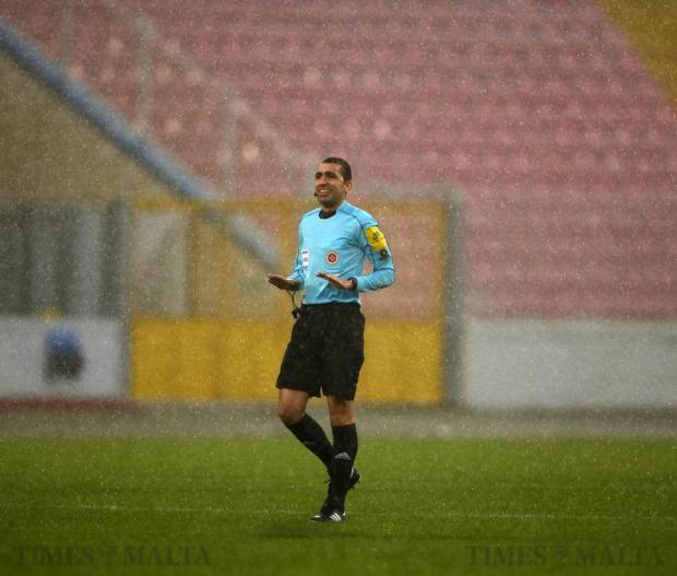 Referee Alan Mario Sant stands in pouring rain while officiating the Premier League football match between Valletta and Floriana at the National Stadium in Ta' Qali on December 17. Photo: Darrin Zammit Lupi