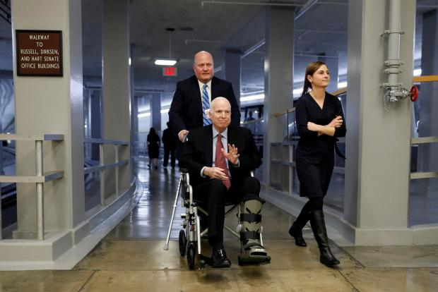 Senator McCain heads to the US Senate to vote in December 2017. Photo: Reuters