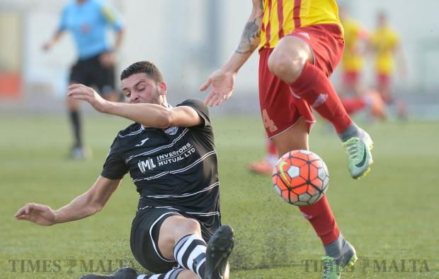 Balzan's Justin Grioli slides in for the ball during their premiership match against Birkirkara at the Tedesco Stadium in Hamrun on October 16. Photo: Matthew Mirabelli