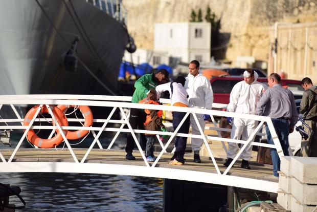 A young migrant is inspected upon arrival in Malta. Photo: Mark Zammit Cordina