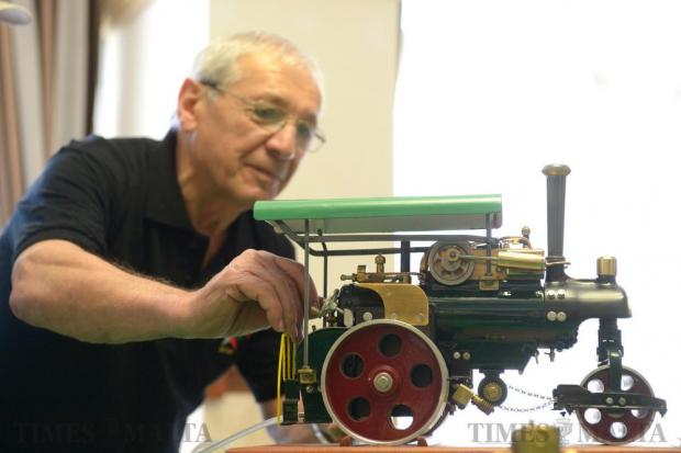 Joe Vella adjusts one of his models powered by compressed air. It was among the 500 models on display at a Die-Cast and Scale Model Society exhibition on May 22. Photo: Matthew Mirabelli