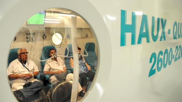 A nurse and patients in the hyperbaric unit.