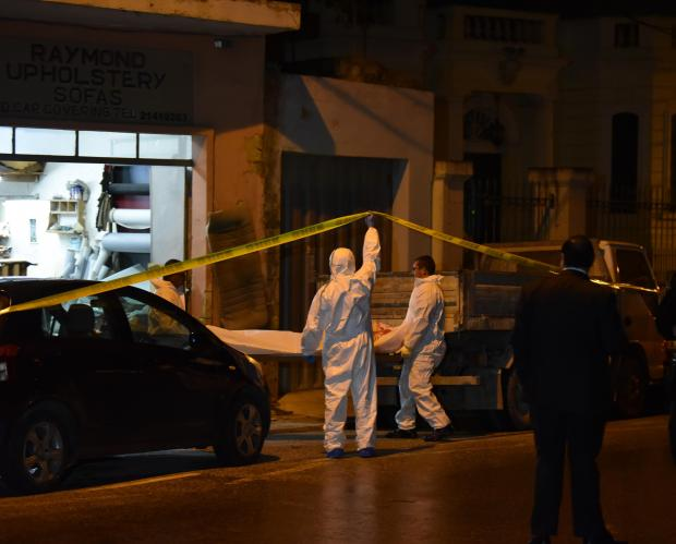 Members from Forensic unit remove a dead body from a garage in Attard where a man was also severely wounded November 17. Photo: Mark Zammit Cordina