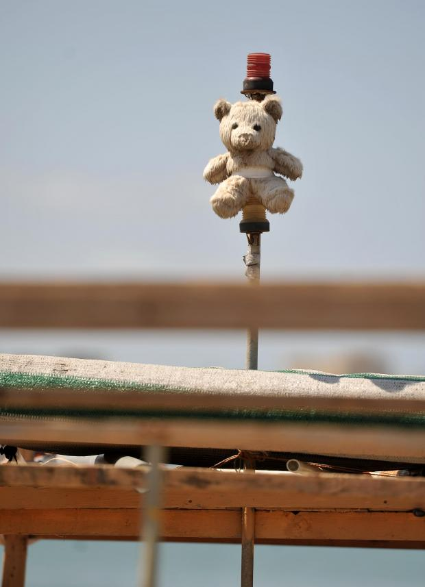 A mascot teddy bear stands watch on a Luzzu fishing boat in Marsaxlokk on July 26. Photo: Chris Sant Fournier
