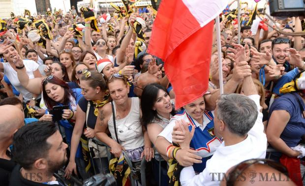 Simon Busuttil greats supporters attending a mass meeting in Sliema on May 28. Photo: Matthew Mirabelli