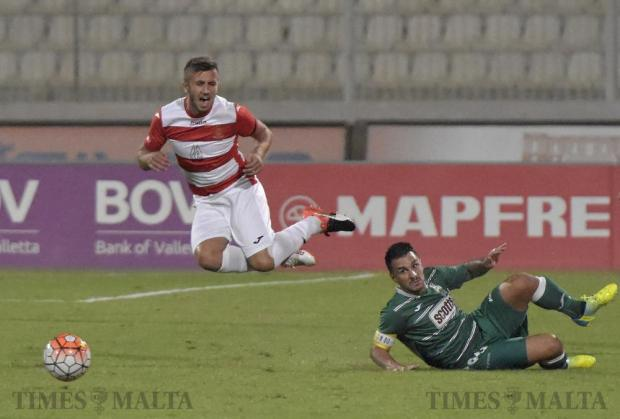 Valletta's Llywelyn Caruana is tackled by Floriana's Nicholas Chiesa during their Premier League football match at the National Stadium in Ta' Qali on September 21. Photo: Mark Zammit Cordina