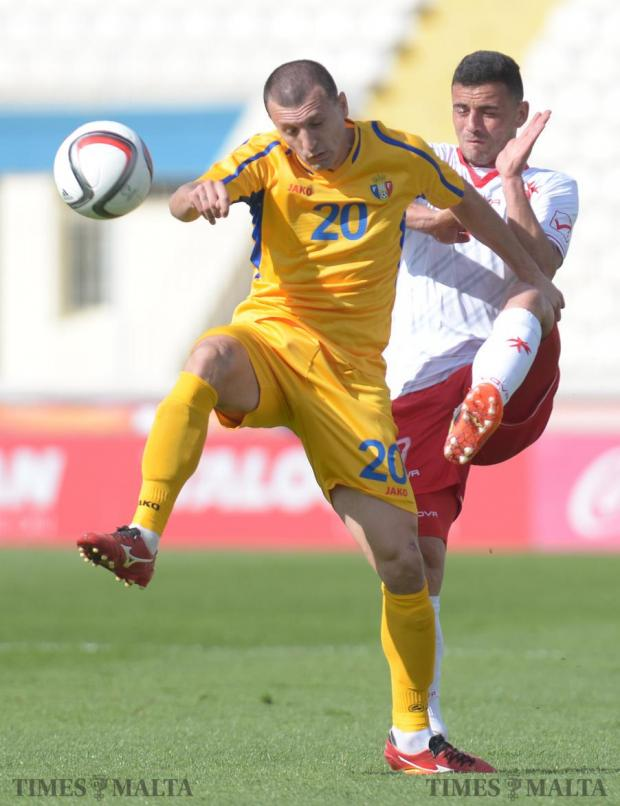 Moldova's Eugeniuo Sidoreno (left) beats Malta's Clayton Failla to the ball during an International friendly match at the National Stadium in Ta'Qali on March 24. Photo: Matthew Mirabelli