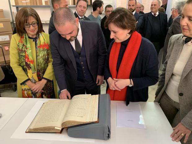 Culture Minister Owen Bonnici reading the restored volume