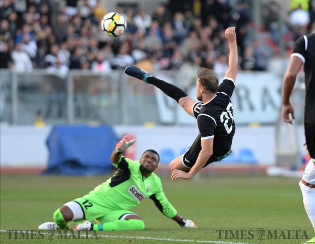 Hibernians Andrei Agius takes a shot at goal during the BOV Super Cup final match against Floriana at the National Stadium in Ta'Qali on December 13. Floriana won the match 1-0. Photo: Matthew Mirabelli