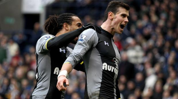 Tottenham Hotspur's Gareth Bale (right) celebrates scoring his side's first goal of the game, with team-mate Benoit Assou-Ekotto during the Barclays Premier League match at the Hawthorns, West Bromwich. Photo: Nick Potts, PA Wire