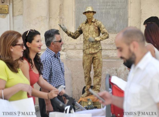A busker stands statuesque in Republic Street Valletta on June 19. Photo: Chris Sant Fournier
