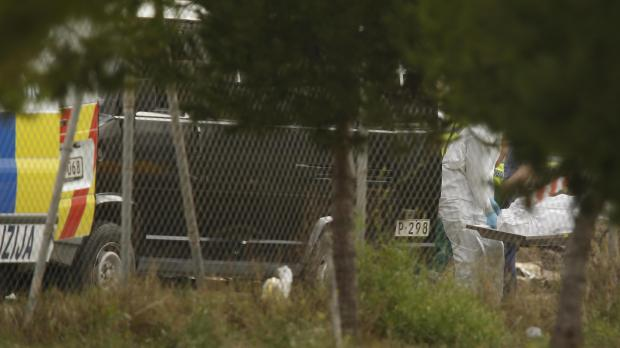 A forensics team moves the body of one of the deceased crew members. Photo: Darrin Zammit Lupi