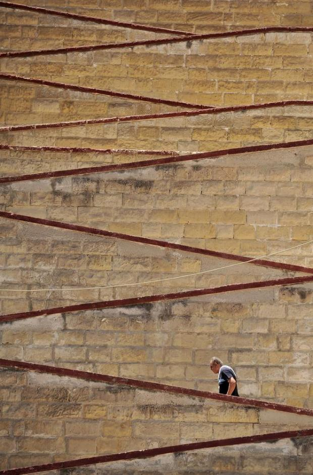 A man makes his way up steps in Cospicua on July 20. Photo: Chris Sant Fournier