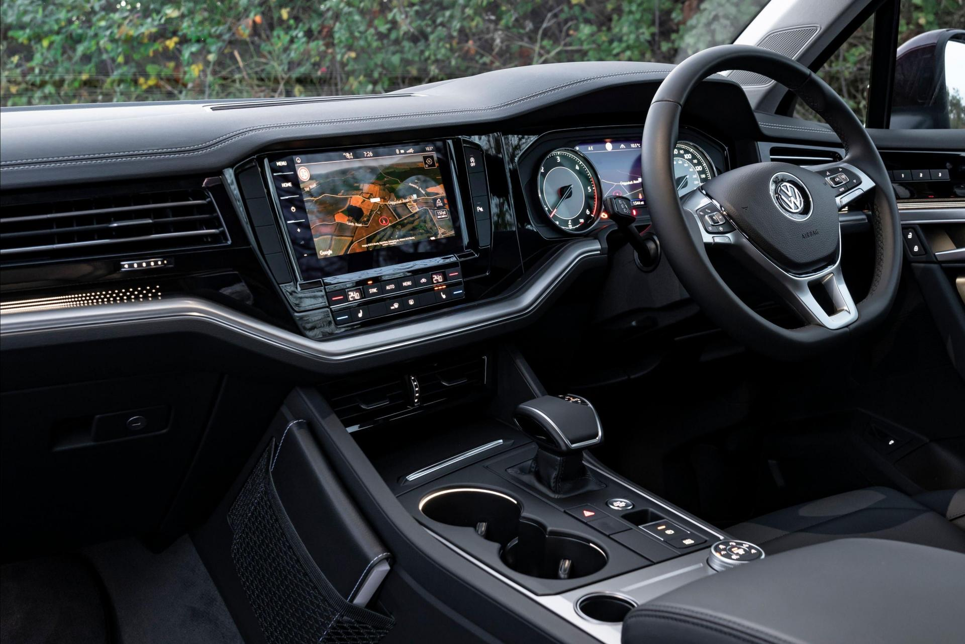 A large infotainment screen dominates the Touareg's cabin.