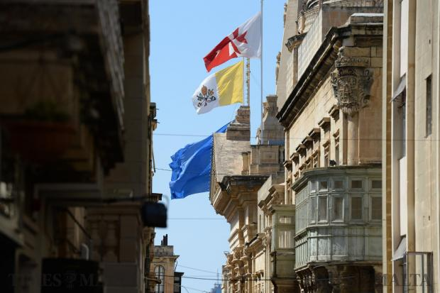 Flags fly above the streets in Valletta on June 16. Photo: Matthew Mirabelli