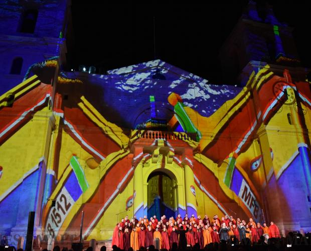 A projection of a traditional Maltese fishing 'Luzzu' is lit up on St Johns Co Cathedral in Valletta whilst a choir sings during the opening ceremony of Valletta 18 European Capital of Culture on January 20. Photo: Mark Zammit Cordina.