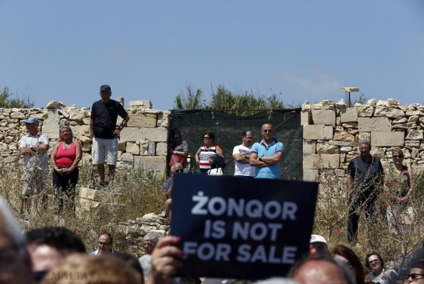 "People attend a Nationalist Party rally opposing ""the sale of national heritage"" at Zonqor Point on May 31. Photo: Darrin Zammit Lupi"