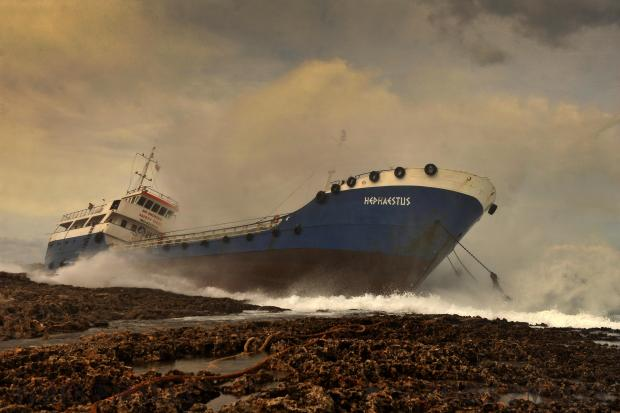The ill-fated tanker The Hephaestus, which ran aground after breaking its moorings on February 10, sits helpless, battered by waves on the rocky Qawra shore. Photo: Chris Sant Fournier