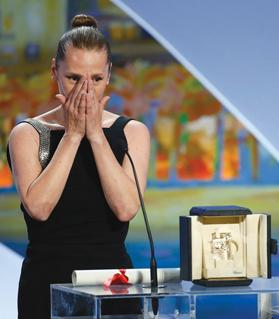 Actress Emmanuelle Bercot, best actress award winner for her role in the film Mon roi, ex aequo with actress Rooney Mara, reacting on stage during the closing ceremony of the festival. Photo: Eric Gaillard/Reuters