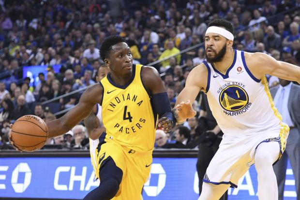 Indiana Pacers guard Victor Oladipo (4) dribbles the basketball against Golden State Warriors center JaVale McGee (1) during the first quarter at Oracle Arena. Photo Credit: Kyle Terada-USA TODAY Sports