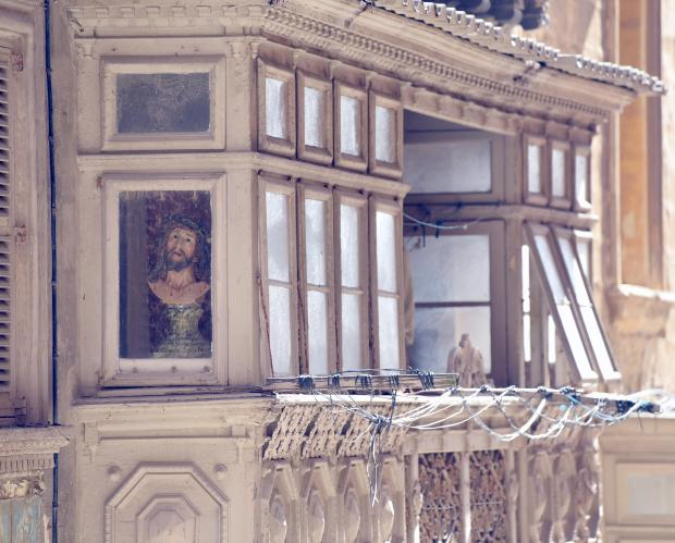 A bust of the Ecce Homo watches from a balcony in Valletta on February 25. PHOTO: MARK ZAMMIT CORDINA
