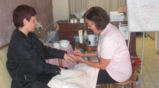 Photo shows a manicure session at the event.